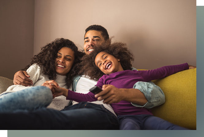 Mom, dad and daughter relaxing on couch. everyone is smiling